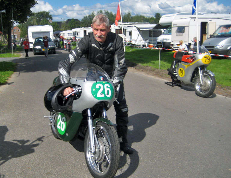 Crusty determined TT racer on his way to the grid.